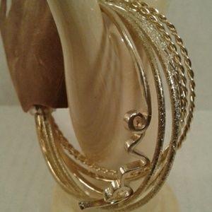 Set Of 7 Bangle Bracelets  Gold in color